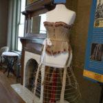 Crinoline hoop skirt: Metal, leather, and cotton muslin  c. 1890 YO1-C350-01. Corset: Metal, cotton, and thread  c. 1890 YO1-364-04 both donated by Helen Daniels
