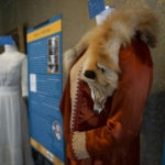 1920 – Rust colored satin dress: Satin, ecru, felt, and brass studs Donated by Sylvia Baldwin Dilgard YO1-C201-32