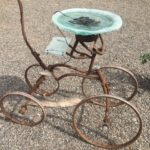 """Mary Bayard White, For the Birds #5, Reused window glass and bike parts, solar pump, plants 42"""" x 8' x 24"""""""