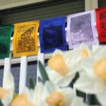 Melissa West, Prayer Flags in Action, Linoleum block prints on cloth, 10', 2020
